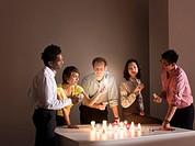 A group examining a lightbulb