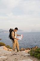 Hiker cheking his map in Ibiza, Spain