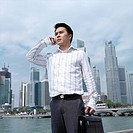 Low angle view of a businessman talking on a mobile phone