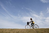 A young woman riding a bicycle
