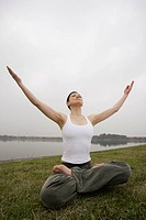 Front view of a young woman in lotus position