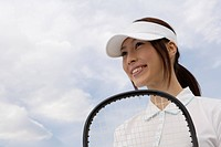 A young woman holding a racquet