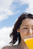 A smiling young woman with drinks