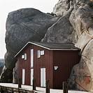Log cabin built into rocks