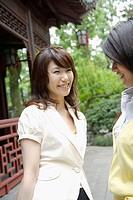 Young women conversing, side view