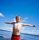 A boy wet from a swim.