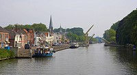 Boats are moored at the banks of Merwede canal, bascule bridge in the background, Nieuwwegein, Netherlands, Europe