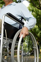 Senior man on wheelchair, mid section