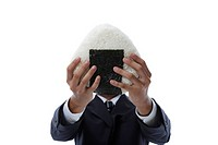 Businessman holding large rice ball in front of face, close_up