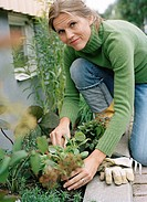 A woman planting plants.