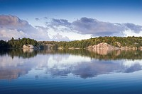 Early fall reflection on George Lake in Killarney Provincial Park, Ontario, Canada