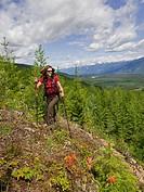 A woman enjoys the tremendous scenery on a beautful day near Valemount, Thompson Okanagan region, British Columbia, Canada