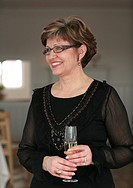 Scandinavian woman holding a glass of champagne Sweden.