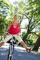 A young woman with a bicycle Sweden.