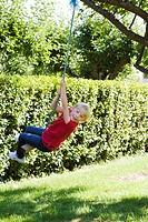 A girl on a swing Sweden.