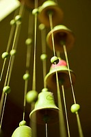 Green bell wind chimes hanging in Casa Oro in San Juan del Sur, Nicaragua