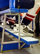 The feet of a ice hockey player.