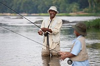 African grandfather and grandson fishing