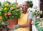 African florist holding flowerpot
