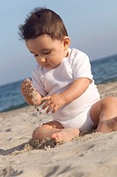 INFANT PLAYING OUTDOORS Model.