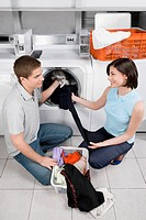 Couple in a laundromat