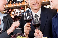 Business executives toasting with wine