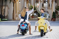 Three friends having fun on mopeds, Biltmore Hotel, Coral Gables, Florida, USA