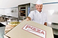Chef holding a pizza box