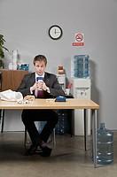 Businessman drinking beverage in lunch break
