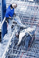 High angle view of two construction workers working at a construction site