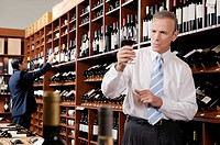 Businessman holding a wine glass