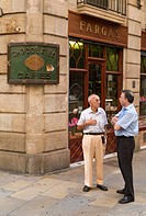 Two men on street corner in Barcelona Spain