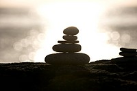 A stone stack against a setting sun