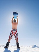 topless man with snowboard