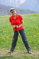 Blonde mature woman nordic walking