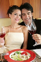 couple in love drinking red wine in a restaurant