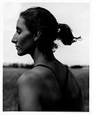 ponytail, athlete, somber profile portrait