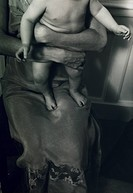 Baby Standing in Mother´s Lap
