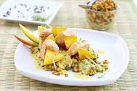 Turkey and mango skewers on lentil salad