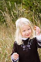 Little girl with a salted pretzel in her hand