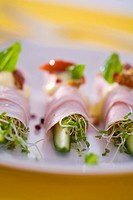 Cucumber sticks and cress wrapped in ham