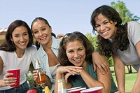 Four women at outdoor picnic.