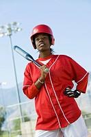 Young woman holding softball bat portrait