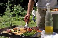 Man barbecuing vegetables