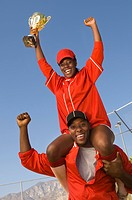 Coach and softball player celebrating