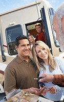 Couple receiving keys to RV portrait