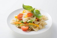 Farfalle primavera with vegetables and basil