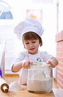 Little girl with flour and rolling pin