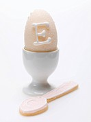 Sugar egg in eggcup with baked spoon