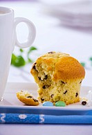 A muffin, partly eaten